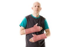 Young man with two red fiberglass plaster arm casts Royalty Free Stock Photography