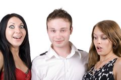 Young man and two surprised young women. Young man and two surprised beauty young women Stock Photography