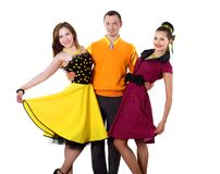 Young man with two women in bright colour wear. Swing style Royalty Free Stock Image