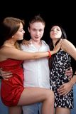 Young man and two young women Royalty Free Stock Images