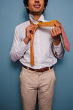 Young man tying his tie Royalty Free Stock Images