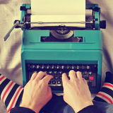 Young man typewriting, with a retro effect Royalty Free Stock Image