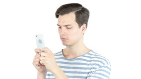 Young man typing email ,sms ,massage  on smart phone , isolated white background. Talented Man, Creative Designer, freelancer, employee, worker stock video footage