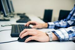 Young man typing on keyboard. Royalty Free Stock Photography