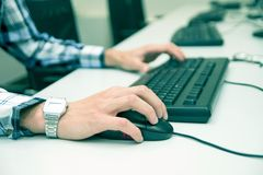 Young man typing on keyboard. Stock Photos