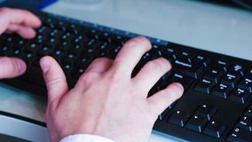 Young man typing on a pc keyboard, technology business concept. Close-up of a young man typing on a pc keyboard, technology business concept stock video