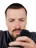 Young man typing a short text message Royalty Free Stock Photo