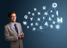 Young man typing on smartphone with high tech 3d letters comming Stock Photography