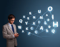 Young man typing on smartphone with high tech 3d letters comming Royalty Free Stock Photography