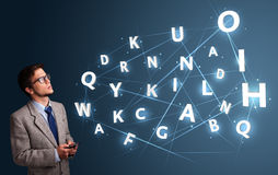 Young man typing on smartphone with high tech 3d letters comming Royalty Free Stock Photos