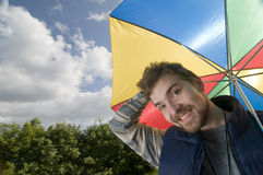 Young man with umbrella Stock Photo
