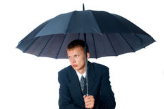 Young man with an umbrella. On a white background Royalty Free Stock Photos