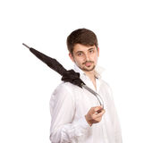 Young man with umbrella Stock Images