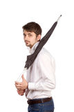 Young man with umbrella Royalty Free Stock Photography