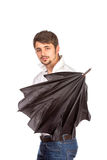 Young man with umbrella Stock Image