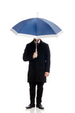 Young man with umbrella isolated on white Stock Photos