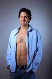 Young man with unbuttoned shirt. Portrait of a young man with unbuttoned shirt Royalty Free Stock Images