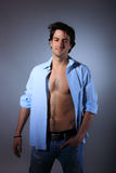 Young man with unbuttoned shirt. Portrait of a young man with unbuttoned shirt Stock Photography