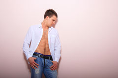 Young man with unbuttoned shirt Stock Photo