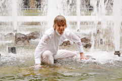 Young man under fountains Royalty Free Stock Images