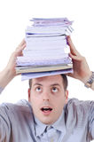 Young man Under a pile of books on his head Stock Photography