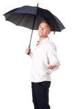 Young man under an umbrella stock images