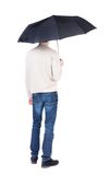Young man under an umbrella. Stock Photo