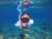 Young man underwater portrait. Male snorkel in tropical lagoon undersea photo. Snorkeling in coral reef. Tropical sea activity. Water sport. Exploring tropical Royalty Free Stock Photography