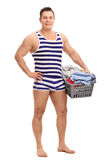 Young man in underwear holding a laundry basket Stock Images