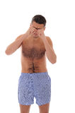 Young man in underwear waking up in the morning Stock Photos