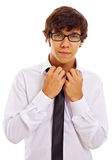 Young man unfastening white shirt Royalty Free Stock Photography