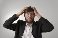 Young man in unfortunate situation Stock Photos