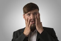 Young man in unfortunate situation Stock Images