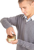 Young man unlocks canned food Stock Image