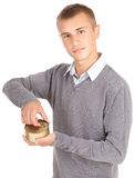 Young man unlocks canned food Royalty Free Stock Photo