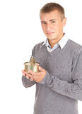 Young man unlocks canned food Royalty Free Stock Image