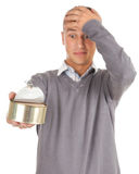 Young man unlocks canned food Stock Photos