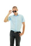 Young man unwearing sunglasses Stock Images