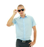 Young man unwearing sunglasses Royalty Free Stock Photo