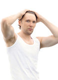 Young Man upsweeping Hair with his muscular arms raised on his Head Royalty Free Stock Photos