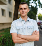 Young man in urban environment. Portrait of a handsome young man in an urban environment Stock Image