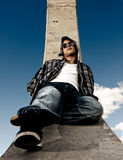 Young man urban fashion over sky background. Young man fashion portrait over sky background stock image