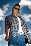 Young man urban fashion portrait over sky. Background Royalty Free Stock Images