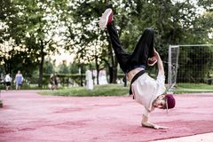 Young man urban subculture hip hop dance in the city park stock photography