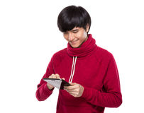 Young man use digital tablet Stock Images