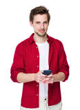 Young man use his mobile phone Stock Images