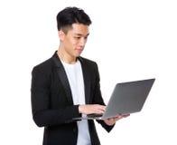 Young man use of laptop computer Stock Photos