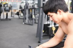 Young man use mobile phone in fitness center. male athlete text Stock Photography