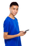 Young man use mobile phone Stock Image