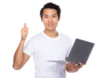 Young man use of notebook computer and thumb up Stock Images